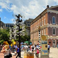 A crowd of tourists and locals at Faneuil Hall